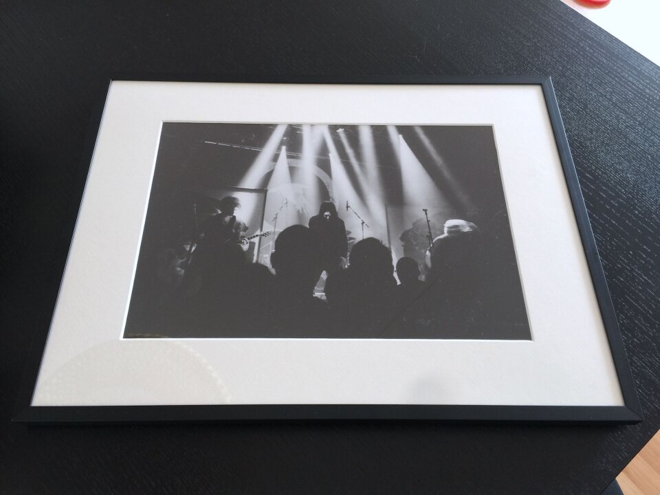 Another large black and white print of a live concert.