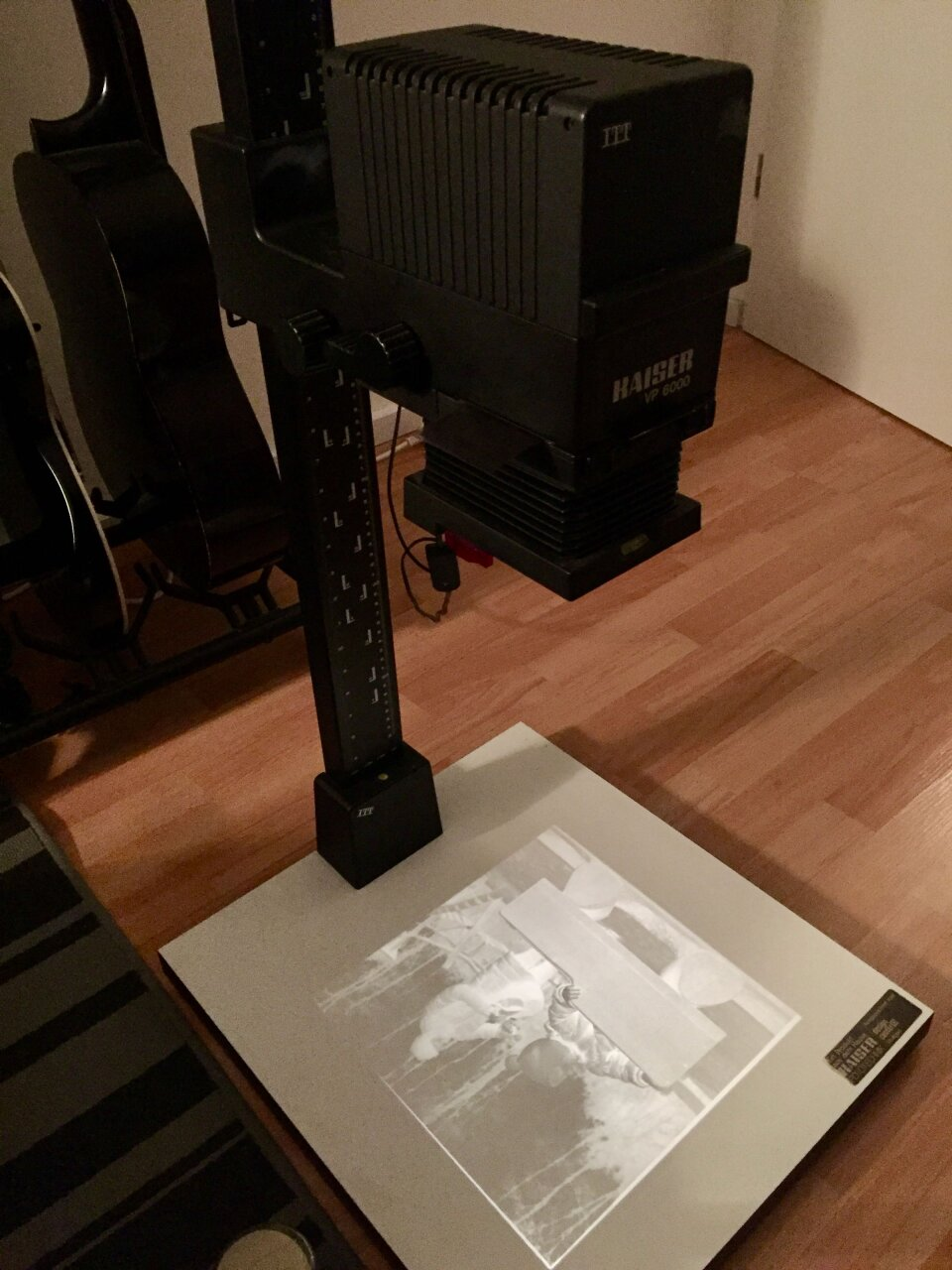 My new Kaiser VP-6000 enlarger in dim light projecting a image onto its base plate
